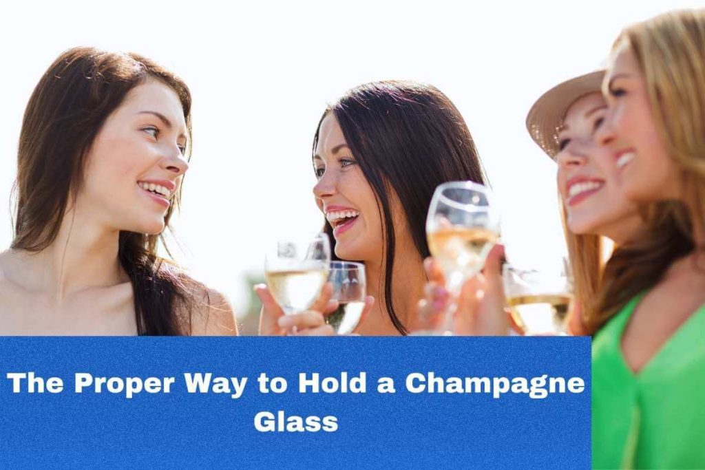 holding champagne glass